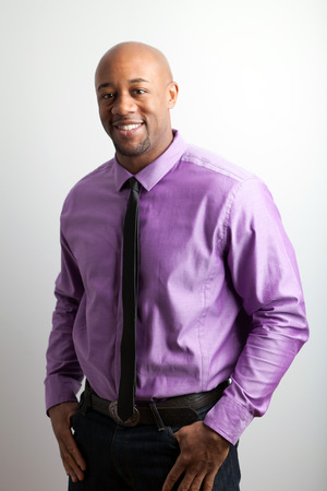 Stylish modern business man wearing a shirt and skinny black tie. photo