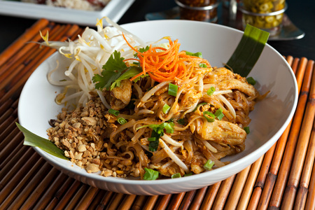 bean sprouts: Chicken pad Thai dish of stir fried rice noodles with a contemporary presentation. Stock Photo