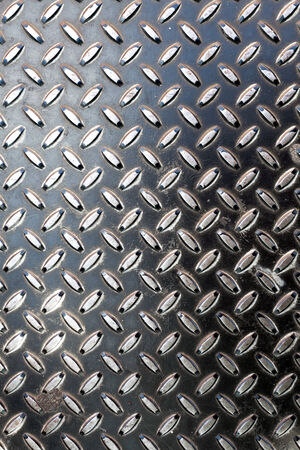 chrome metal: Closeup of real diamond plate metal material. This is the real thing and not an illustration. Stock Photo
