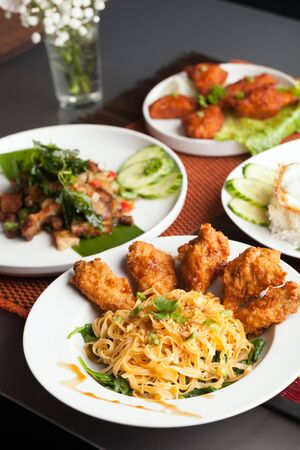 close up food: Thai style foods and stir fry dishes.  Shallow depth of field.