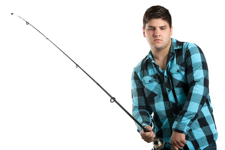 Teenager fishing.  Isolated over white in studio with plenty of copy space. photo