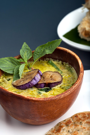 pita bread: A dish of fresh Thai green curry soup with pancakes and appetizer. Stock Photo