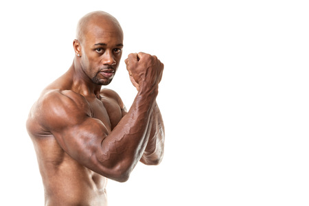 jacked: Ripped and muscular martial artist holding his fists up isolated over a white background. Great boxing or fitness concept. Shallow depth of field.