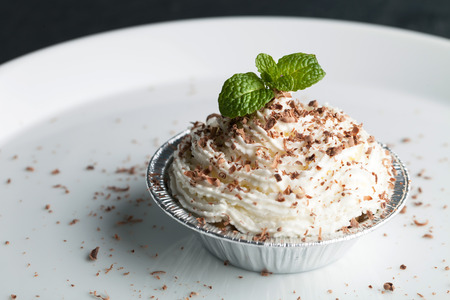 mousse: Parfait dessert with fresh whipped cream and chocolate shavings. Shallow depth of field. Stock Photo