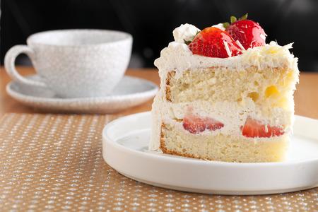 shortcake: Slice of strawberry shortcake with white chocolate shavings. Stock Photo