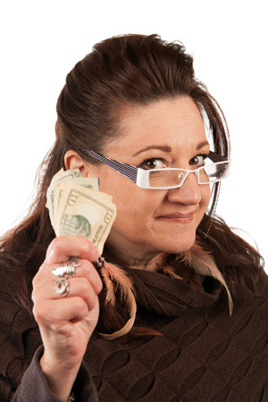 payday: Brunette woman holding up some money in her hand.