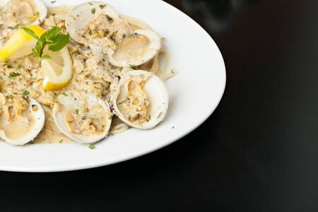 wine sauce: Italian pasta dish with fresh clams over pasta with copy space.