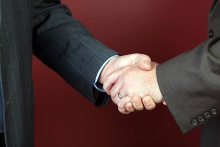 Business negotiations illustrated with a close up of a handshake between two men. Reklamní fotografie