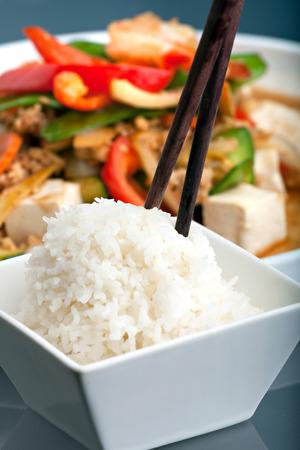 jasmine rice: Fresh Thai food stir fry with tofu and white jasmine rice. Stock Photo