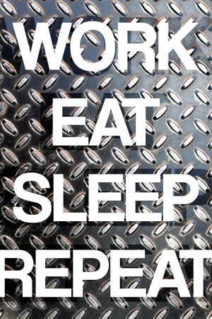 busy person: Diamond plate texture with the words WORK EAT SLEEP REPEAT to illustrate daily life responsibilities of a busy working person. Stock Photo