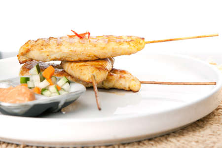 chicken satay: Asian style chicken satay barbecued chicken on skewers with peanut dipping sauce.