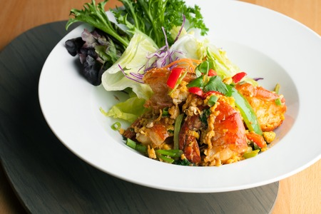jumbo shrimp: Thai jumbo shrimp salad on a round white plate. Shallow depth of field. Stock Photo