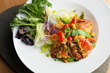 chili's restaurant: Thai jumbo shrimp salad on a round white plate. Shallow depth of field. Stock Photo