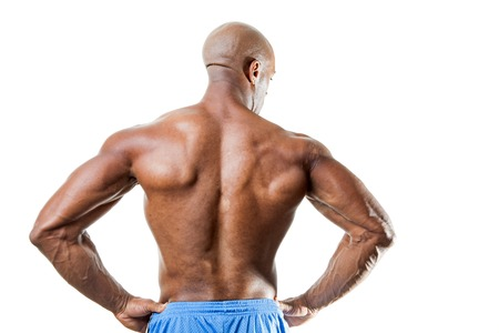 jacked: Toned and ripped lean muscle fitness man standing in front of a white background.