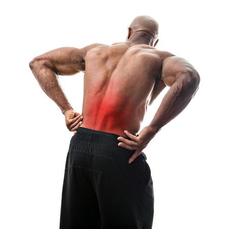 detras de: Hombre apto o deportista alcanzando su baja de la espalda en el dolor con la zona dolorida resaltados en rojo. Foto de archivo