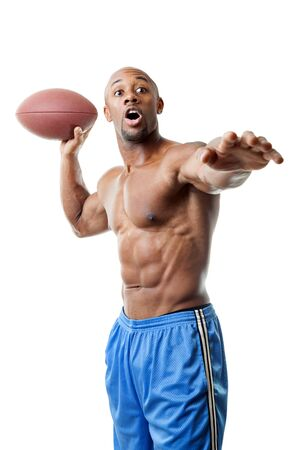 quarterback: Toned and ripped athletic quarterback throwing a football isolated over a white background.