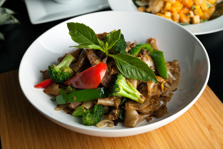 thai chili pepper: Pad kee mao drunken noodle thai dish with beef and mixed vegetables.