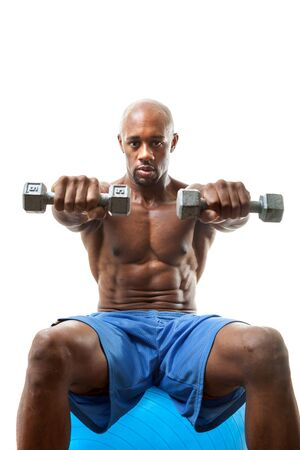 lean over: Toned and ripped lean muscle fitness man lifting weights isolated over a white background. Shallow depth of field. Stock Photo