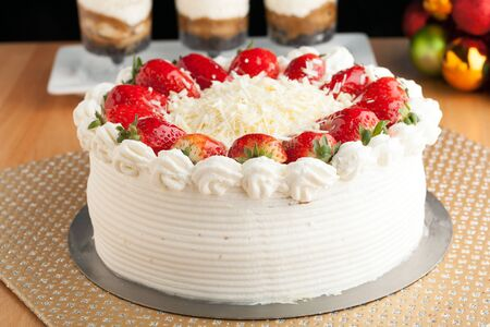 shortcake: Top view of an entire strawberry shortcake with white chocolate shavings.