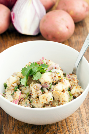 dill seed: Potato salad freshly homemade without mayonaise.  Ingredients include cilantro olive oil vinegar whole grain dijon mustard red onions and potatoes.