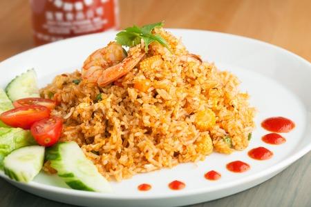prawn: Sriracha shrimp fried rice dish with garnish dots of siracha sauce. Stock Photo