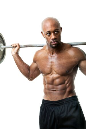 lean over: Toned and ripped lean muscle fitness man lifting weights isolated over a white background.