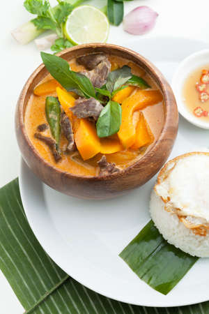 Thai pumpkin red curry with beef and basil. Stock Photo