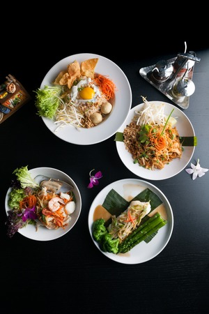 Variety of authentic Thai cuisine and stir fry dishes.  Shallow depth of field. Stock Photo