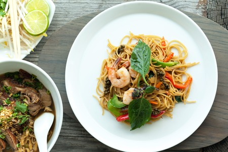 thai noodle soup: Thai food dishes with shrimp and noodles and soup with duck.