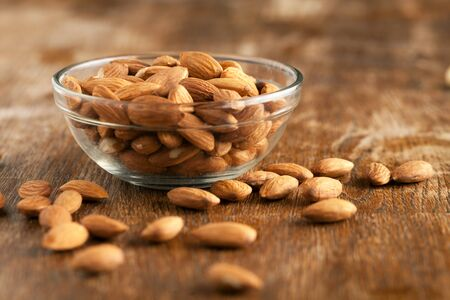 unroasted: Organic almonds in raw form unroasted and unsalted.  Close up macro still life with a shallow depth of field.