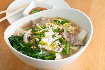 Closeup of some Thai pho style soup with beef and clear rice noodles. Stock Photo