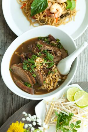 Closeup of some Thai soup with duck and rice noodles. Stock Photo
