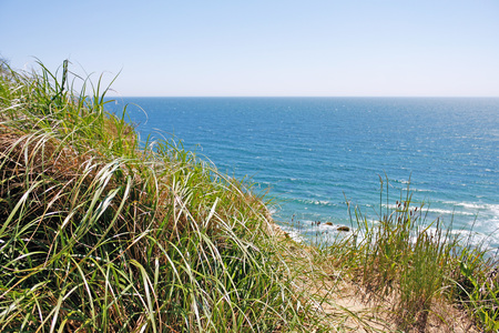 View of the Mohegan Bluffs section of Block Island located in the state of Rhode Island USA. Stock Photo