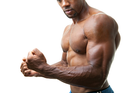 Ripped and muscular martial artist flexing his muscles isolated over a white background. photo