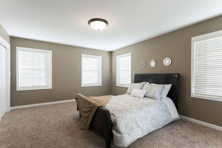 Beautiful staged master bedroom in a modern house.