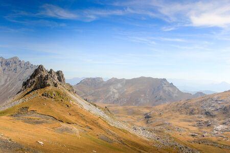 Rock Outcrop Formation and Distant View in the Picos De Europa by Fuente De Spain with Blue Sky