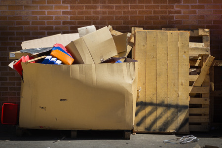 Large Cardboard Garbage Box and Timber Pallets Full of Rubbish Banco de Imagens