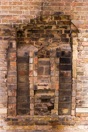 Old Brokendown Brick Wall With Historic Remnants