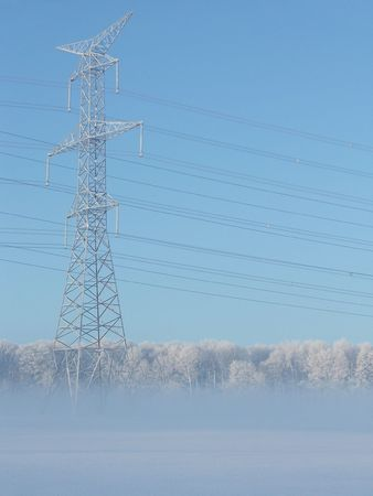 This is one of several images I captured on my way home from work on a frigid February morning. The frosty powerlines seem unaffected by the mist and extreme cold that gave everything else a fragile, ghostly appearance that sparkled in the morning sun.