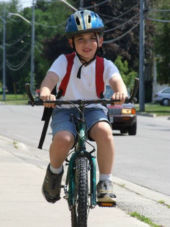 This is one of the first images I captured of the boys with my new camera. It was a surprise shot of Kenny biking home from school.