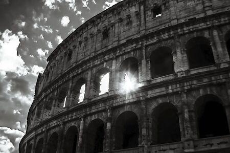 spqr: Artistic sun through the Colosseum Stock Photo