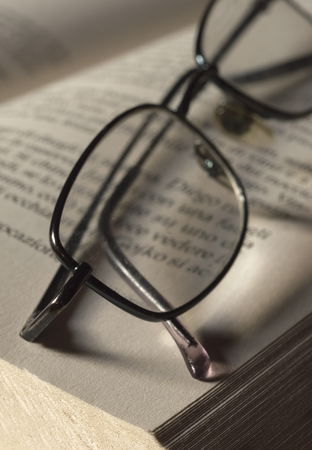 Spectacles on book page Stock Photo