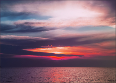 spat: Colourful sunset over the sea Stock Photo