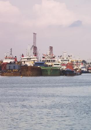 Anchored fishing boats at port