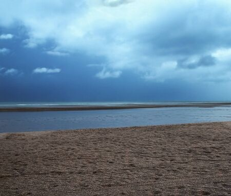 Simple shore on dramatic overcast sky