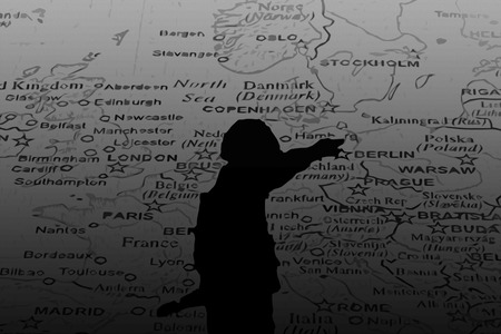 Silhouette of Nazi soldier over map of Europe black and white