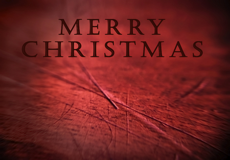 Minimalist red wooden background with Christmas greeting