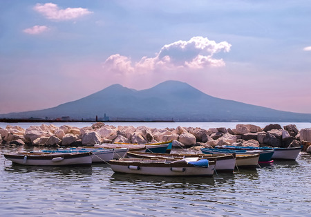 View of fishing boats in Bay of Naples and Vesuvius