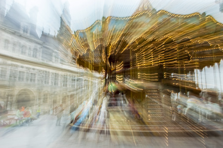 Spinning carousel in radial blur in front of Hotel de Ville in Paris, France Reklamní fotografie
