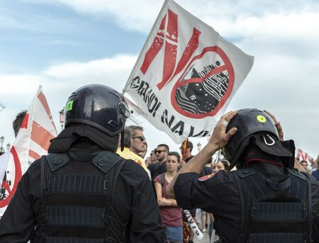 Venice, Italy, 08.06.2019 Two carabinieri in front of protesters against cruise ships in Venice